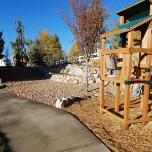 Salmon-rock-rock-retaining-wall-playground-area-vineyard-utah