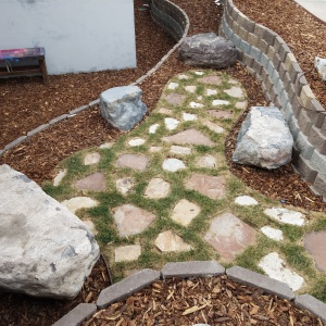 Landscaping-small-block-retaining-wall-Artstone-block-Buckskin-brown-Patio-seating-area-Telos-academy-T3-bike-shop-center-street-Orem-Utah