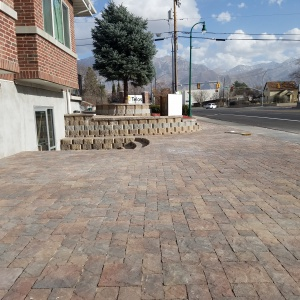 belgard-pavers-Artstone-block-Buckskin-brown-and-natural-color-stair-paver-entrance-Patio-seating-area-Tuscany-pavers-Lehi-pavers-Holland-wasatch-color-Telos-academy-T3-bike-shop-center-street-Orem-Utah